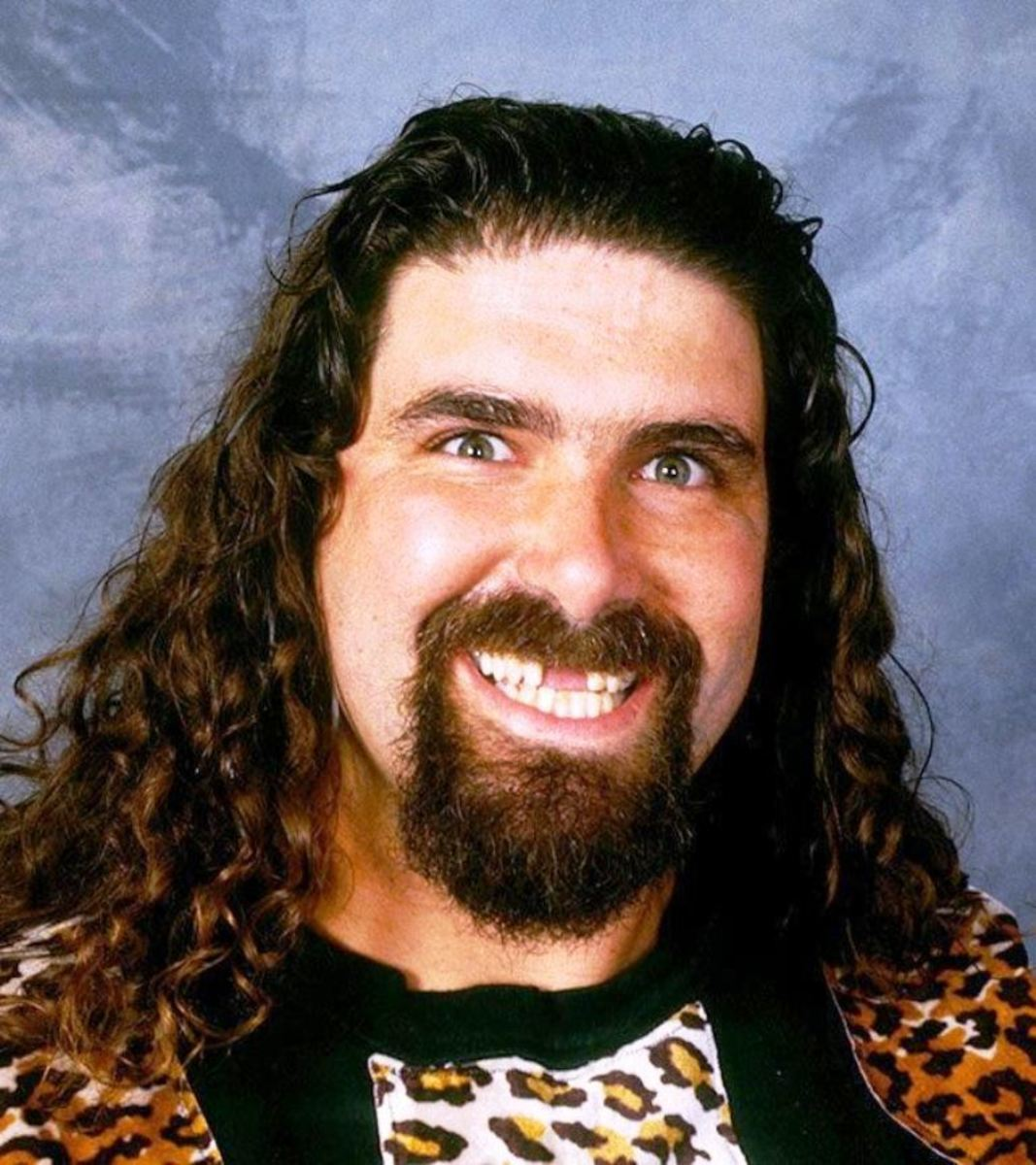 Mick Foley displaying his broken teeth with a smile.
