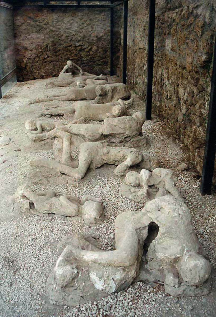"The casts of the corpses of a group of human victims of the 79 AD eruption of the Vesuvius, found in the so-called ""Garden of the fugitives"" in Pompeii."
