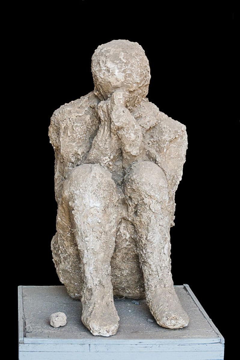 Cast of a sitting victim of the eruption of Mount Vesuvius, 79 CE, Pompeii, Italy