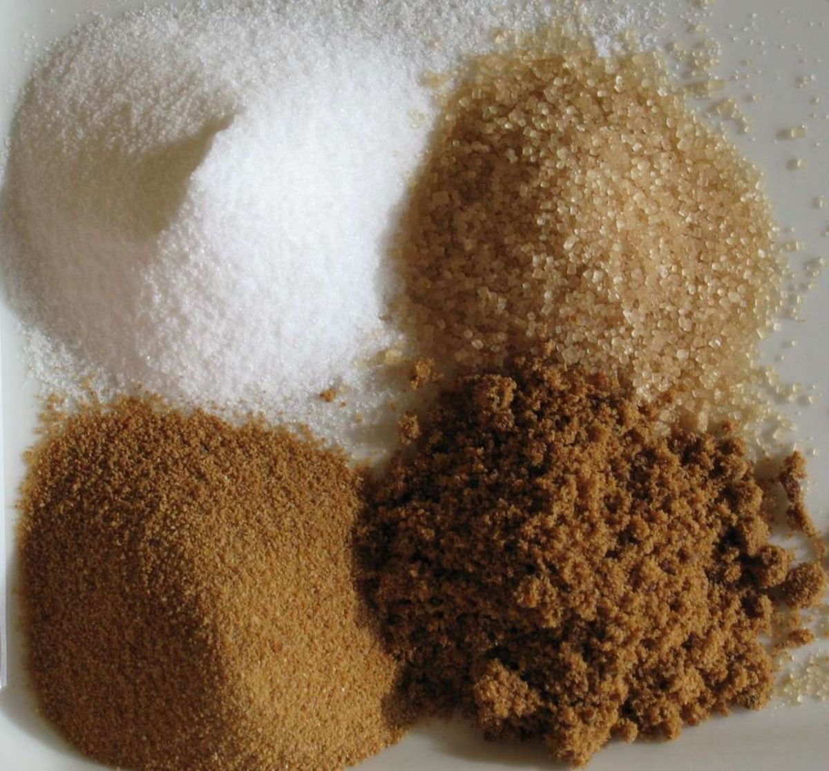 Various stages of sugar purity and refinement. Part of the industrialization of sugar was producing more refined and higher quality sugar.