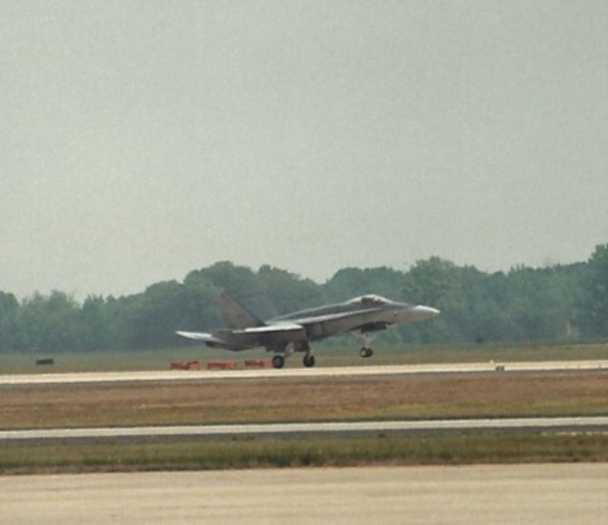 A CF-188 of the Canadian Air Force taking off at Andrews AFB, MD.  Notice the false canopy painted in the aircraft's underside.