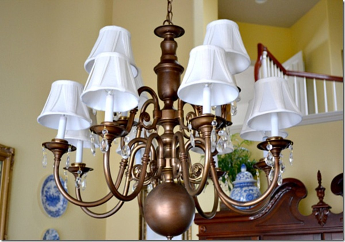 Don't toss the old brass chandelier. Paint will update it.