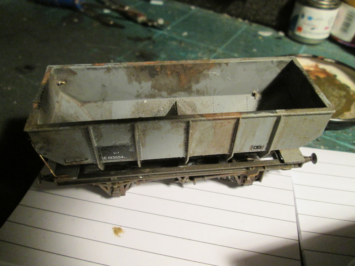 The other side of the first wagon shows a large, dark rust patch on the inside.