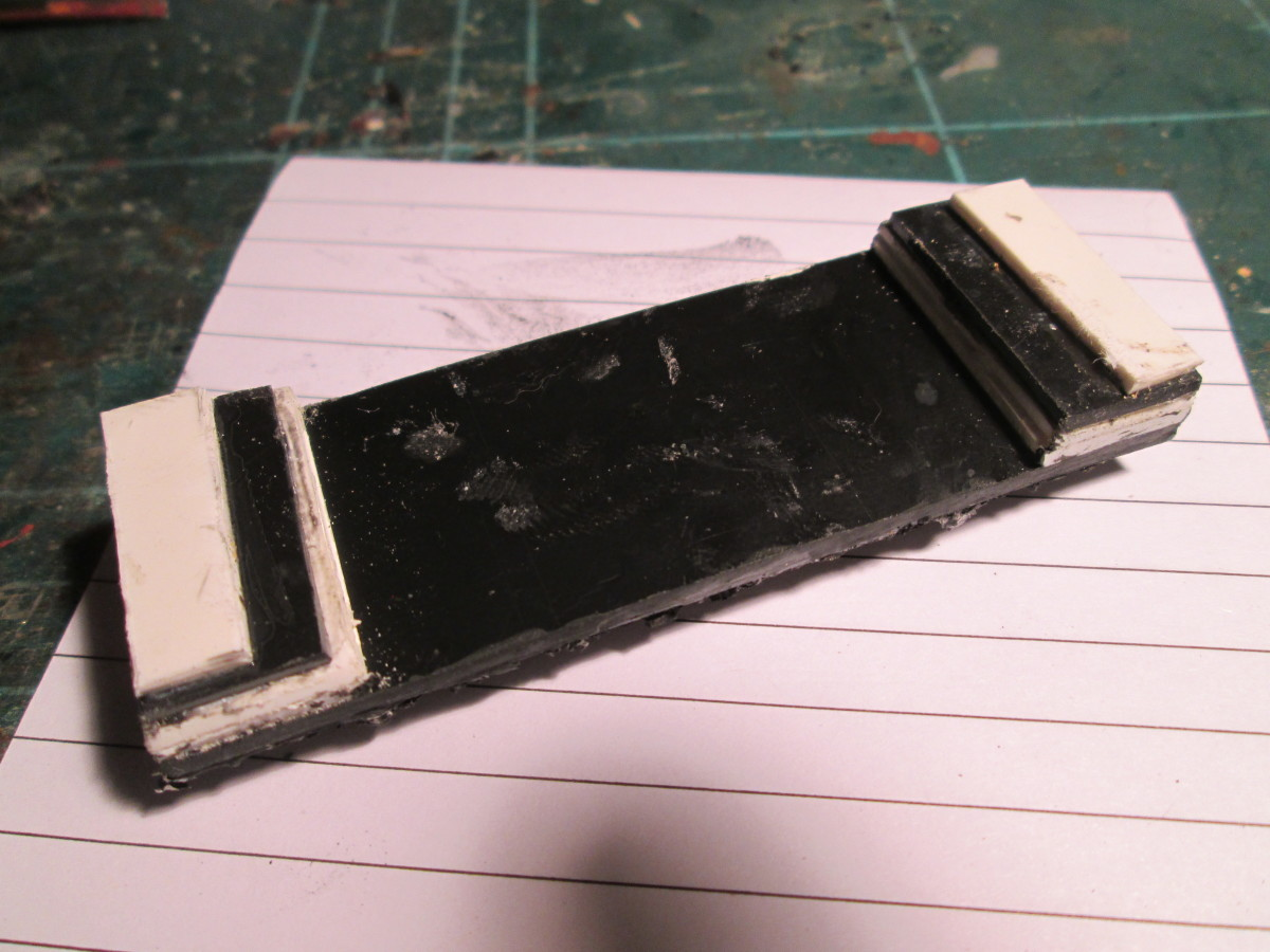 ... And the underside, the plastic strip built up to sit on the hopper slope inside the wagon.