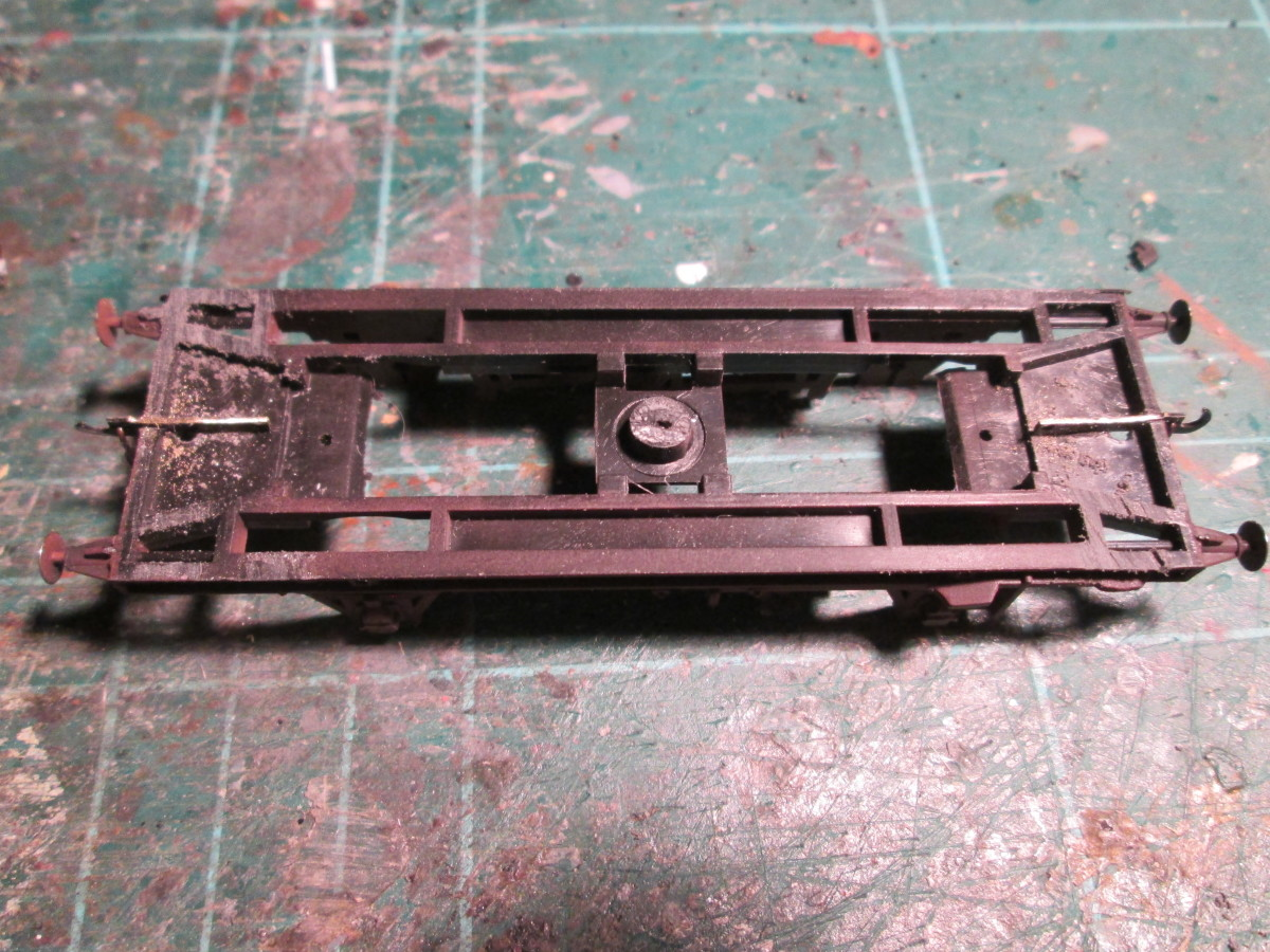 The underframe unit with the coupling shafts in place - cut centrally at the ends to accommodate the coupling shaft. Make the cut very slightly wider than the brass etch. File the tops level with the underframe 'ridge'