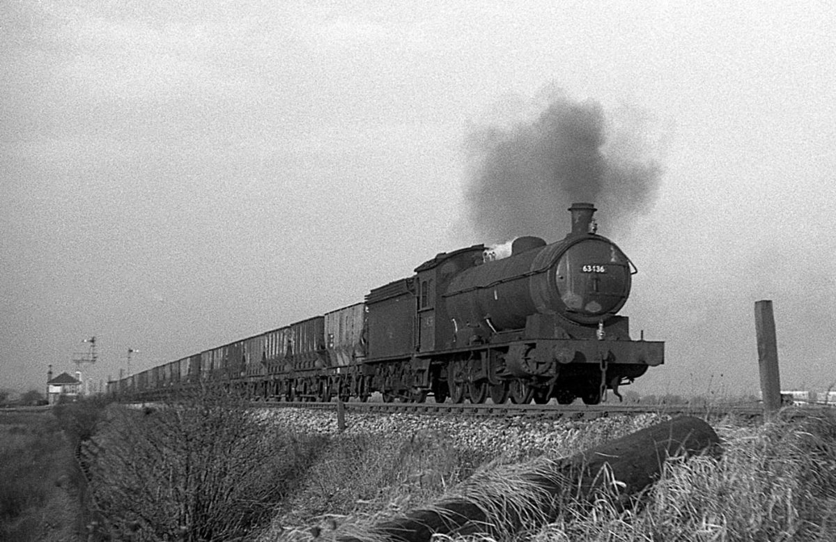 Class Q6 63436 of Sunderland shed (54A) with a long rake of hoppers near Boldon (then in County Durham) with a coal train of divers hoppers