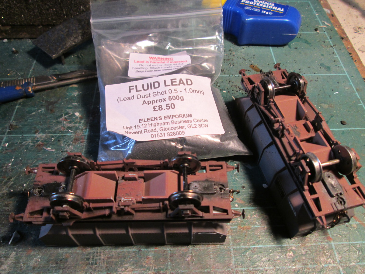 'Fluid lead' in a 500 g bag from Eileen's Emporium - lead shot, the same as you get in a shotgun cartridge! Better than steel ingots because you can 'pour' it into a small space, whereas you'd have to saw the ingot or make-weight