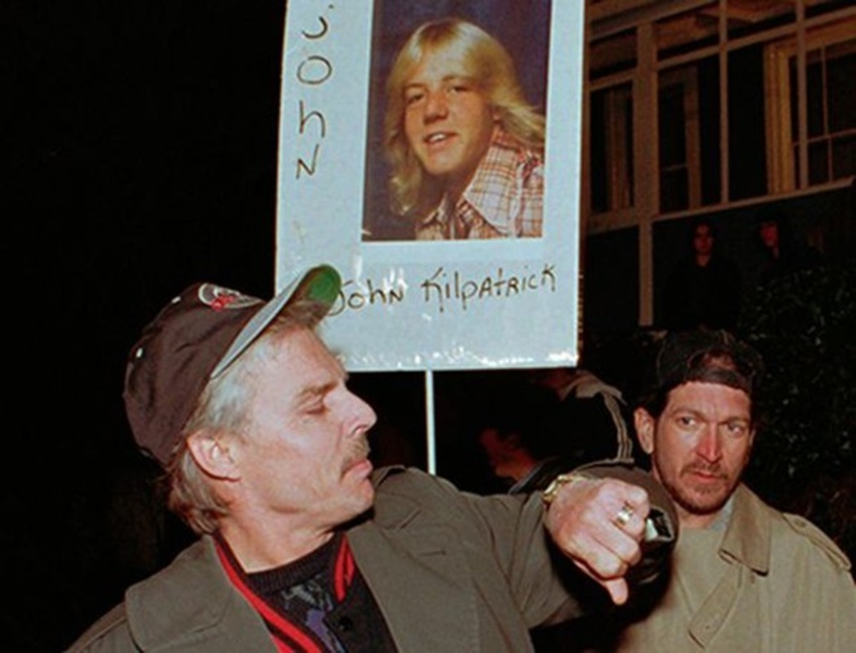 Families of victims and potential victims gathered outside of San Quentin prison the night of William Bonin's execution on February 23, 1996.