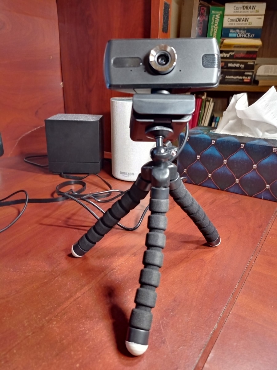 Webcam mounted to tripod