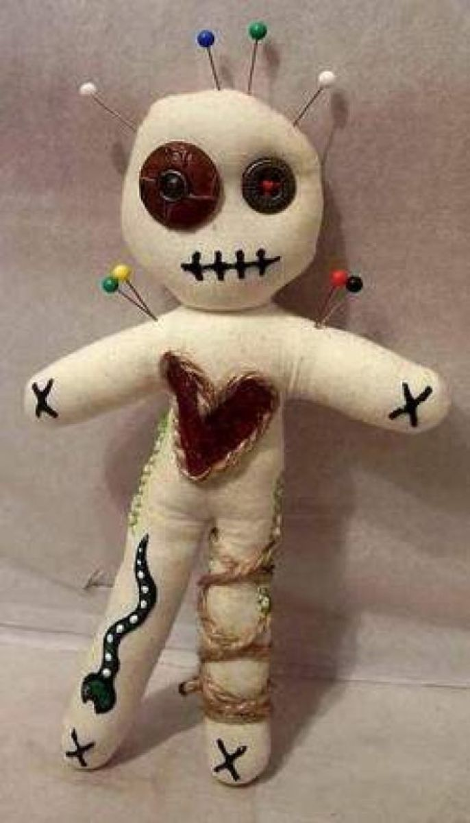 Crafty little doll made from items stored away in a junk drawer.