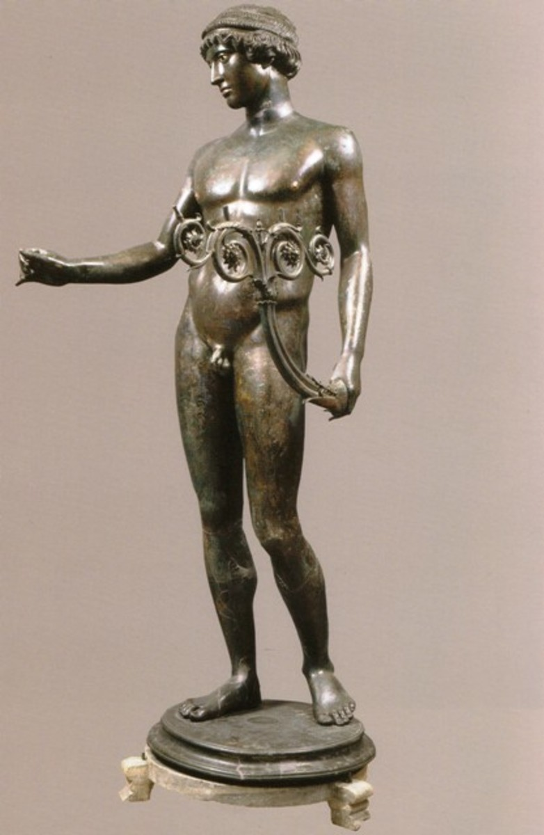 Statuette of an ephebe lampholder, found at Pompeii in an excellent state of preservation.