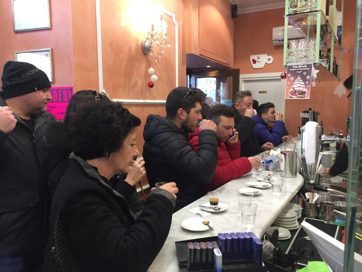 the morning coffee scrum in an Italian bar