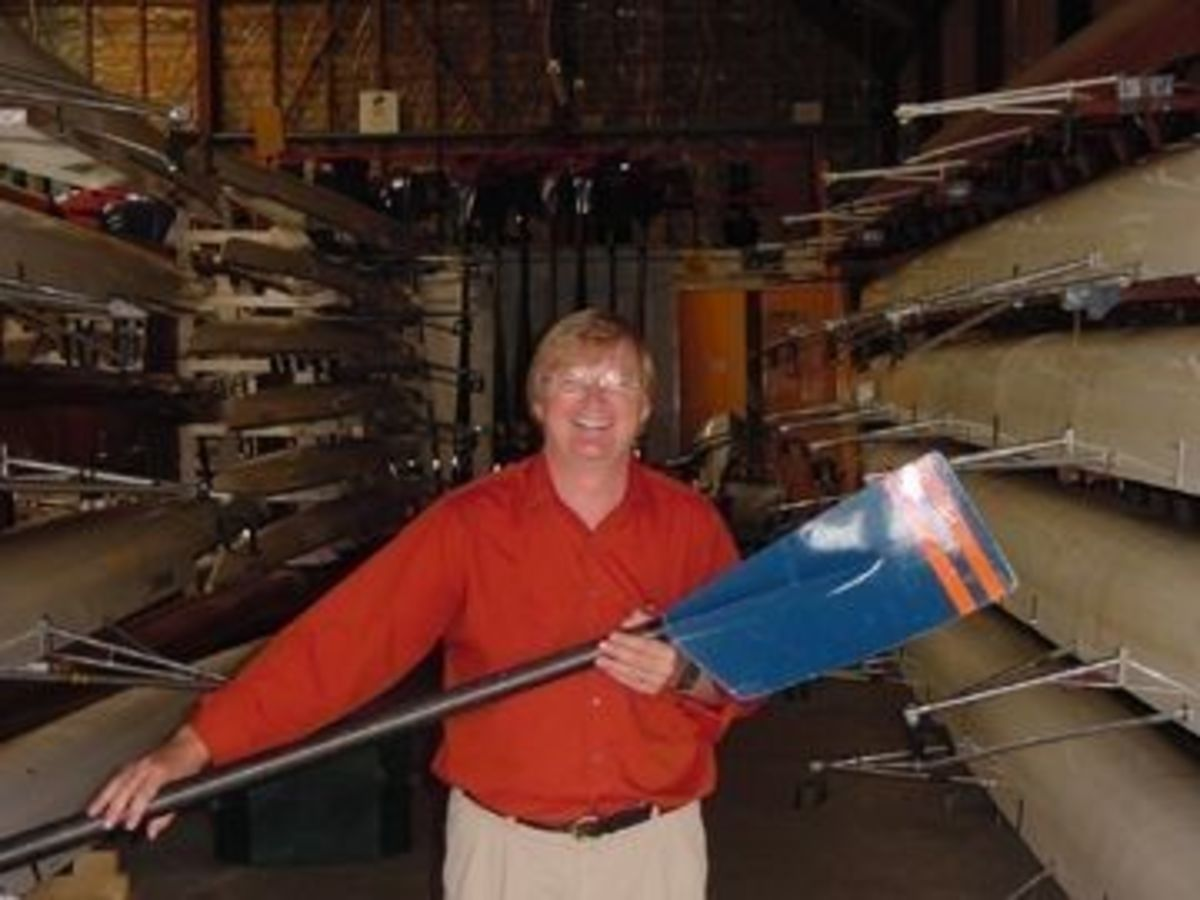 Shown above is Dr. Dale Coleman, of Auburn University, holding a regetta racing oar in Grosvenor boat house in Chester, England.