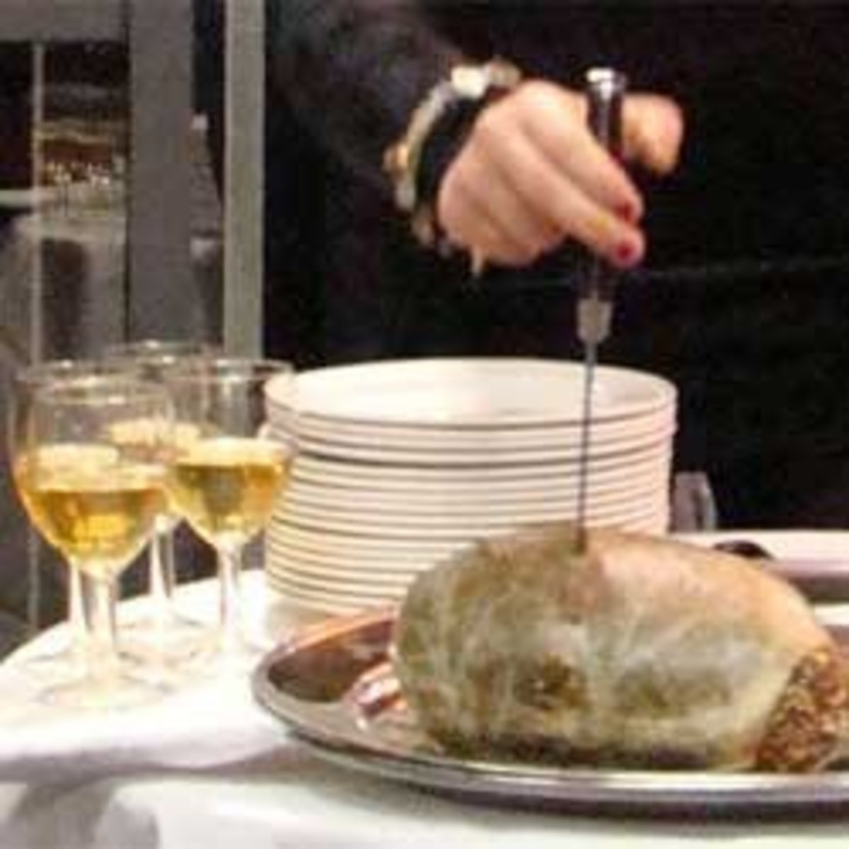 Carving the haggis at a Burns Night celebration.