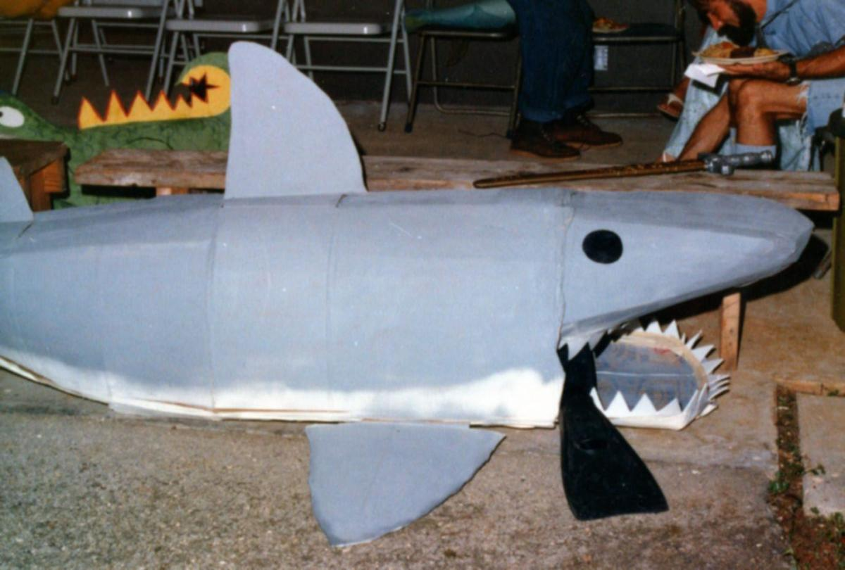 Cardboard shark costume -- taking a break