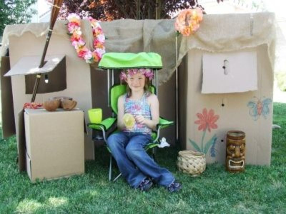 Enjoying a cool tropical drink -- pineapple and mango juice -- on the 'front porch' of a cardboard tiki-hut.