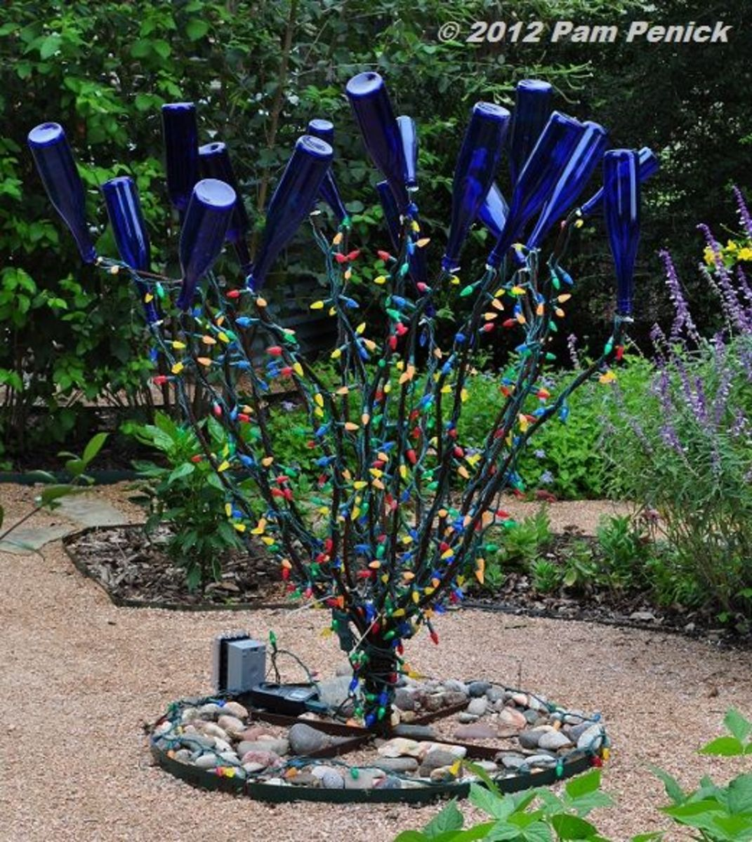 There are many ways people are adapting this African tradition in urban America.I saw one garden where each piece of cobalt blue glass, including saucers and plates are staked into the ground throughout the garden.