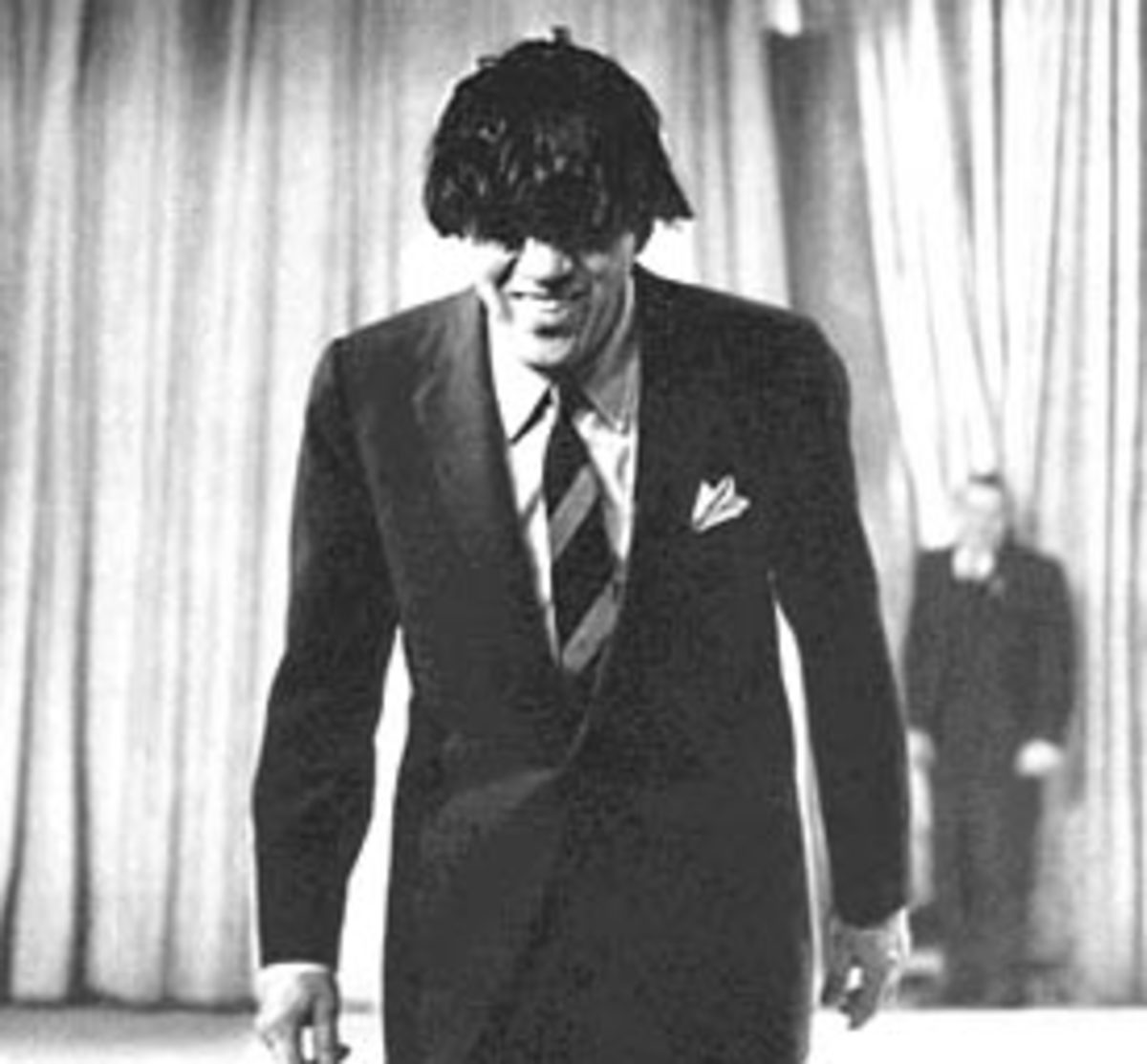 Ed Sullivan, a once very popular TV host, wearing a moptop wig