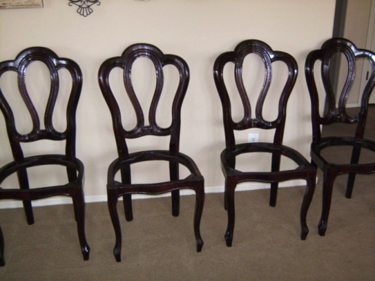 Four of the eight chairs completely de-upholstered.  Halfway there!