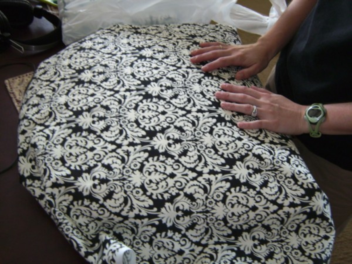 Wrap the fabric around the cushion to measure how much fabric you'll need for each seat.