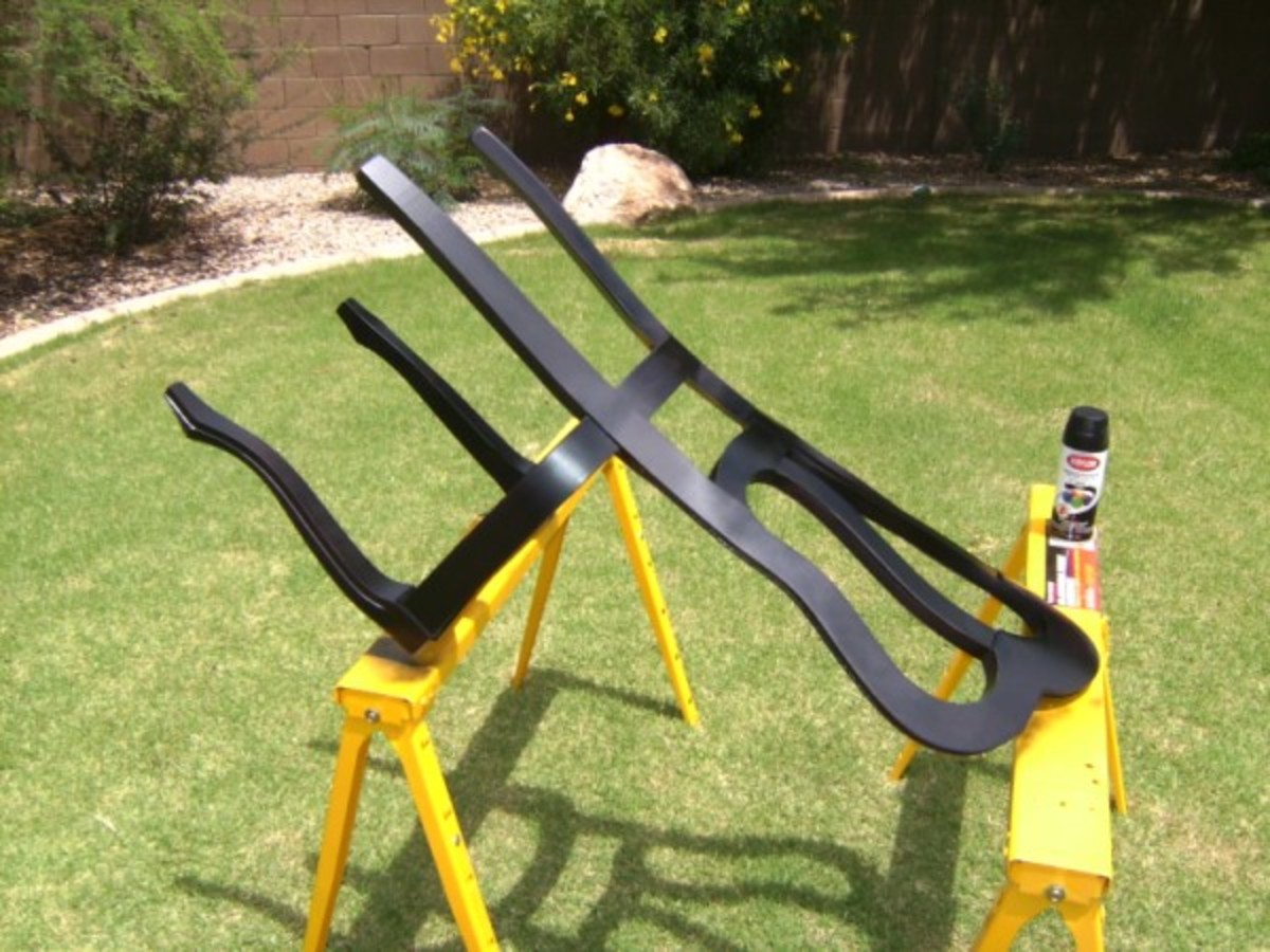 I set the chair on saw horses to spray paint the back and sides.  When the final coat was dry, I set the chair upright and painted the front.