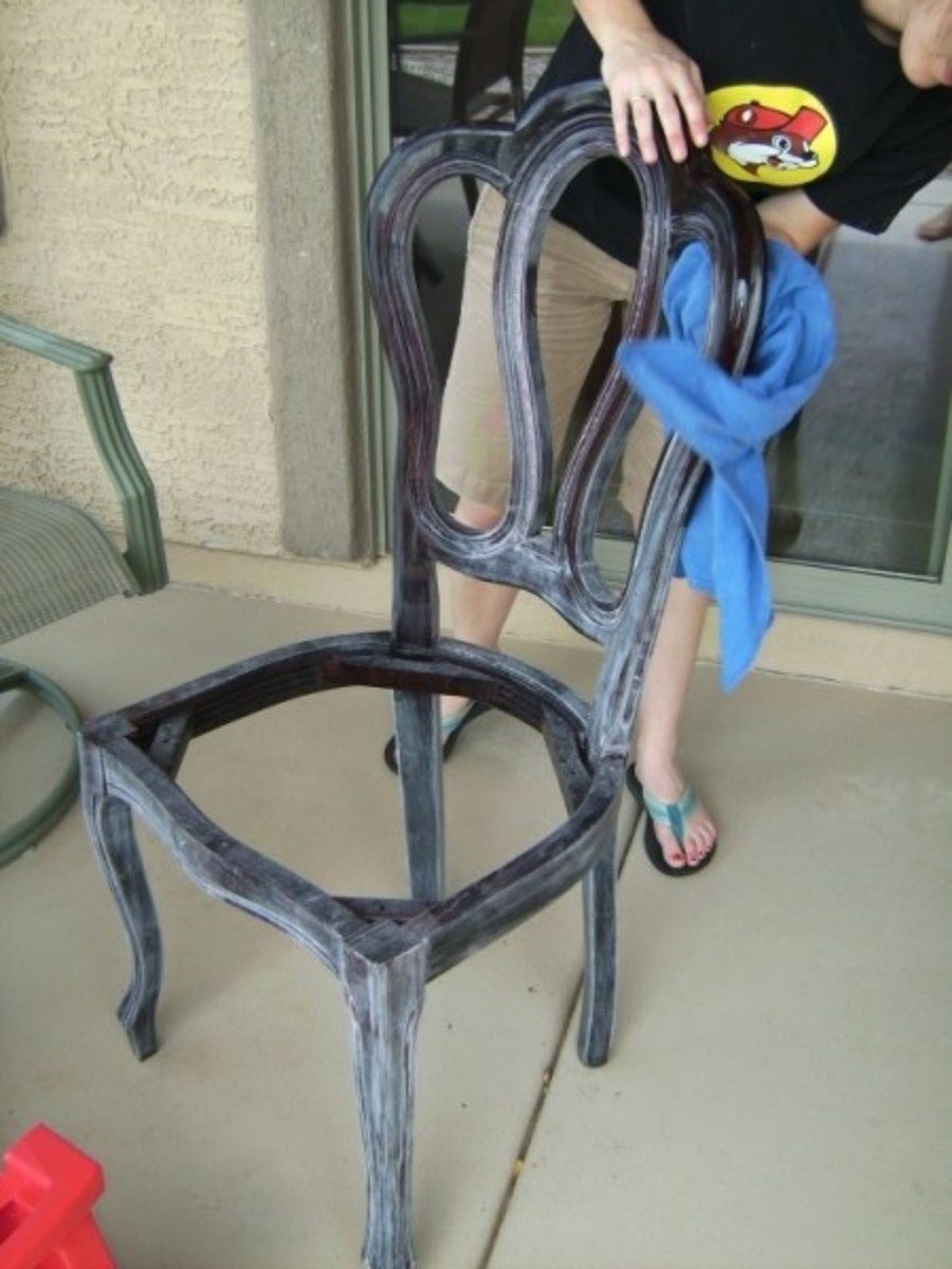 Notice the finish has been sanded all over.  Wiping the chair with a damp rag removes the dust left from sanding.