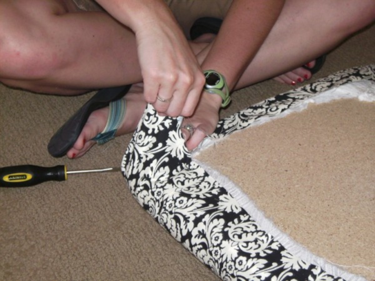 Making the corners look smooth is the hardest part of upholstering the cushion, so be patient and don't get frustrated.  You'll figure it out.