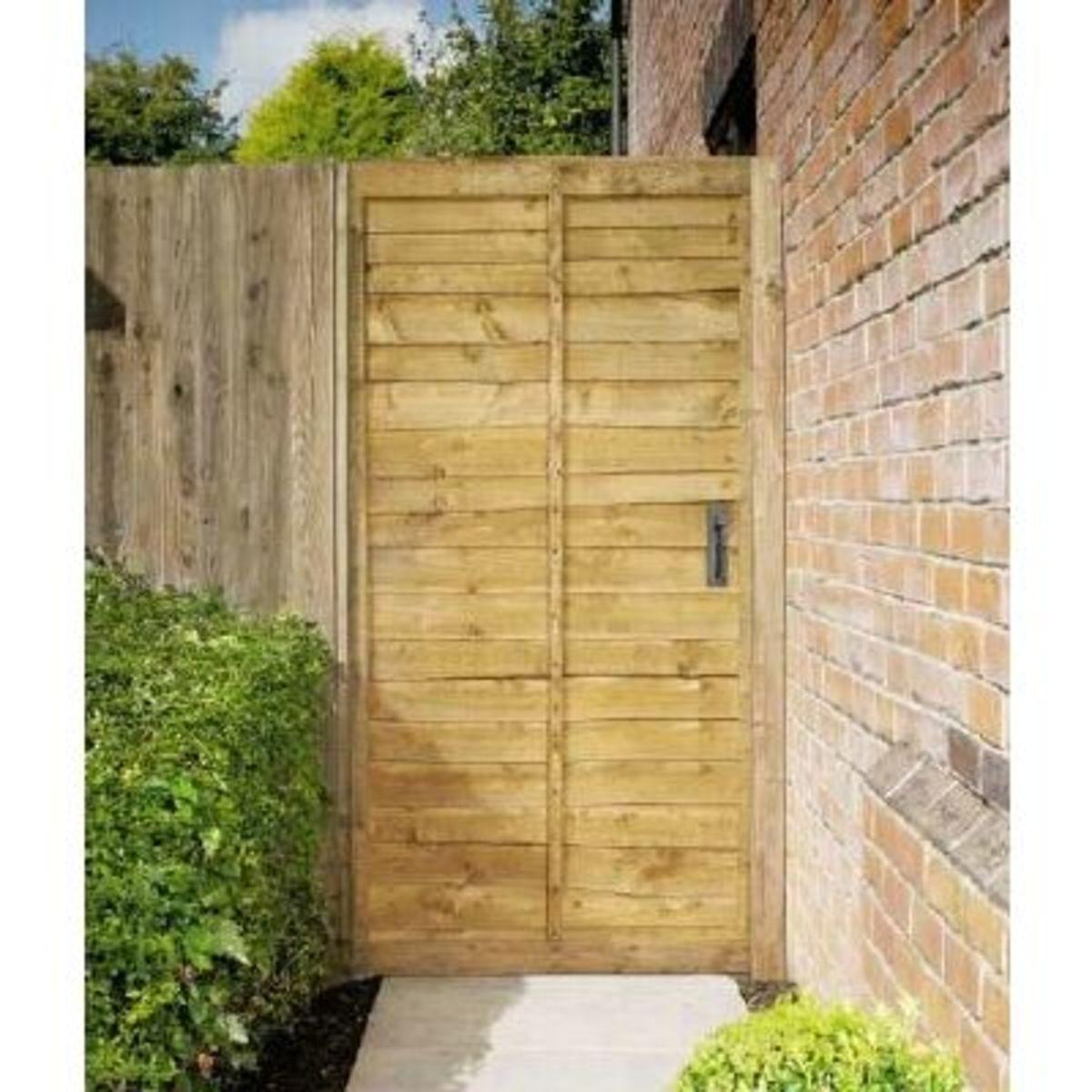 Wooden gates - Tall single side entrance wooden gates - Waney lap gate
