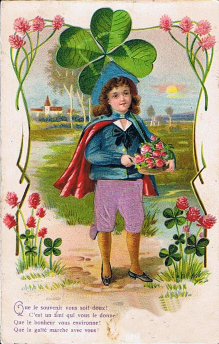 St Patricks Day cards: Irish lad with blue cape, purple pants with large shamrock behind him
