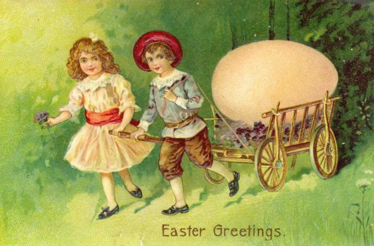 Two cute kids pulling a cart with a giant Easter egg