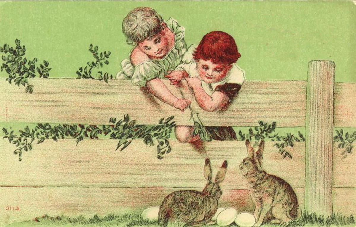 Two cute kids feeding Easter bunnies over a fence