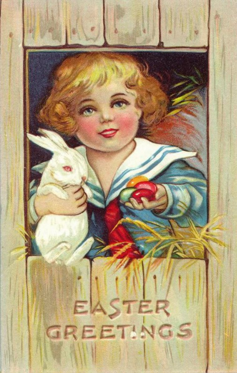 Vintage Little boy in sailor costume with white Easter bunny and colored Easter eggs