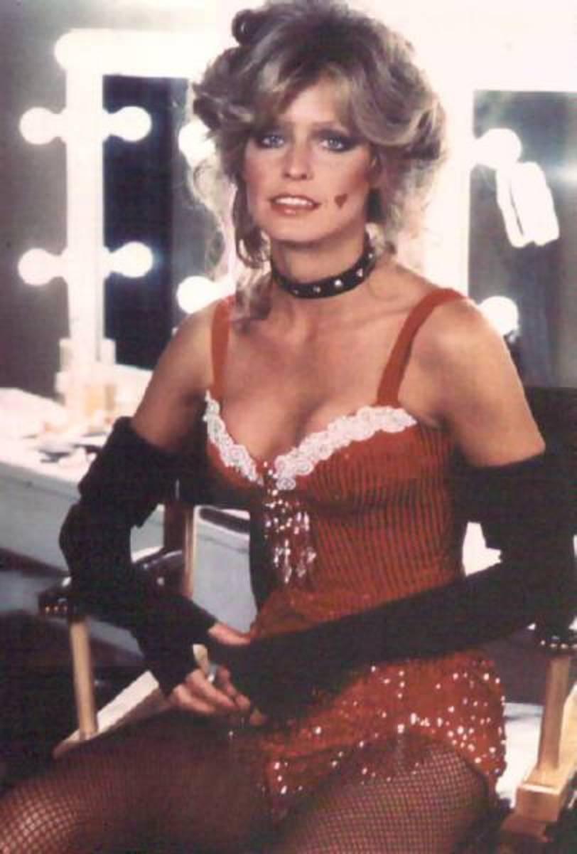 Farrah Fawcett posing in a dressing room