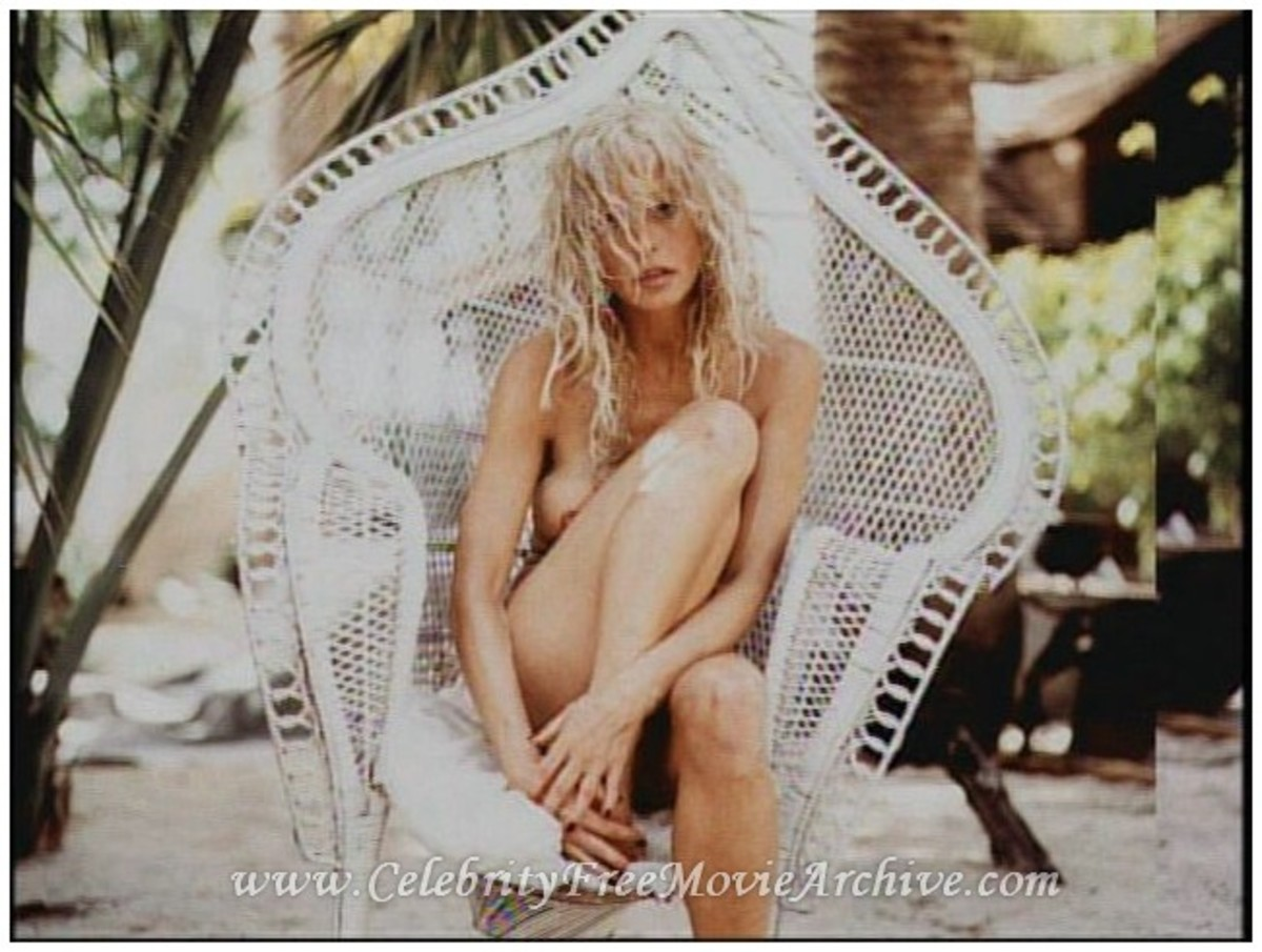 Gorgeous Farrah Fawcett in a wicker chair