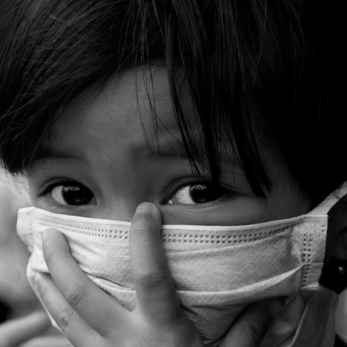 Indonesian Girl Protects Herself from Ash from the Merapi Volcano