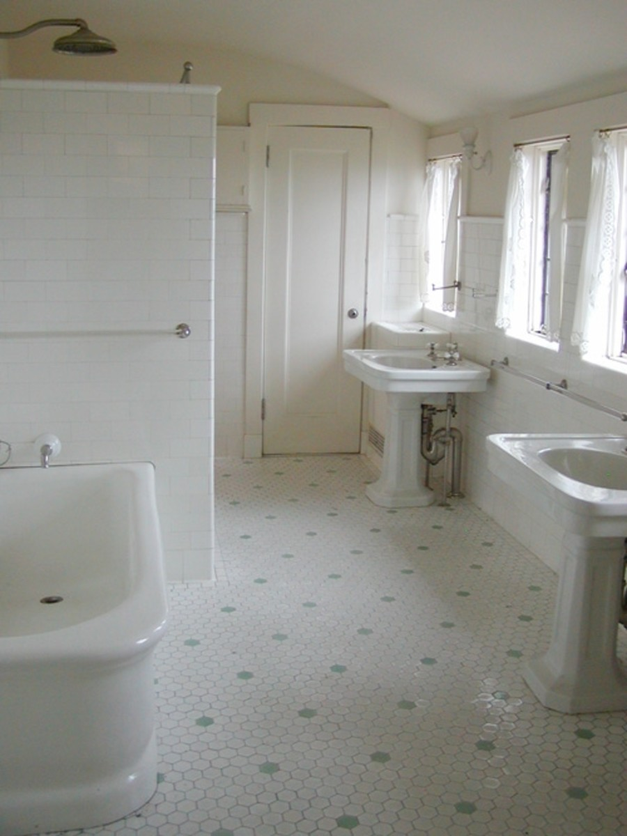 This spacious tiled bathroom is only one of many and features double sinks, a huge bathtub and unique multi-jet shower.