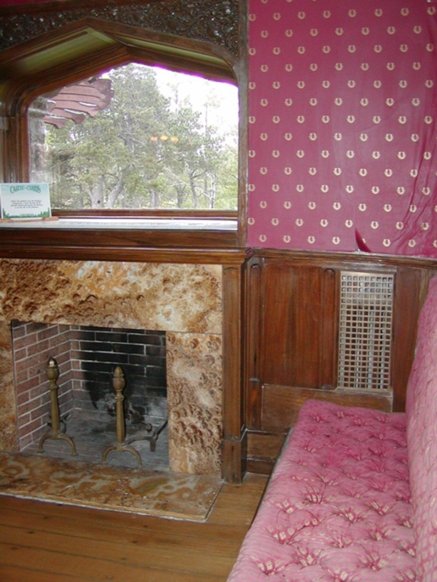 A unique fireplace with window above.