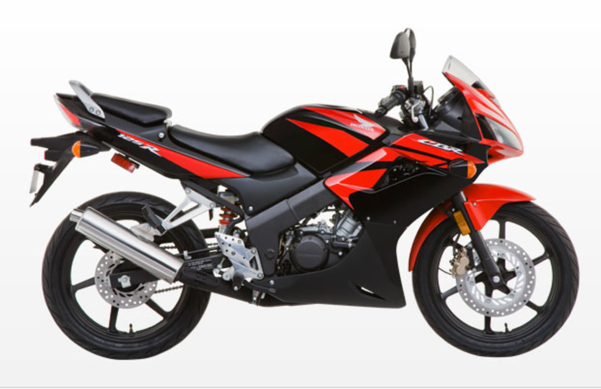 Waaaaaay down on the price scale from the Husky and Aprilia, this 2009 Honda CBR125R is still one buck under three grand!