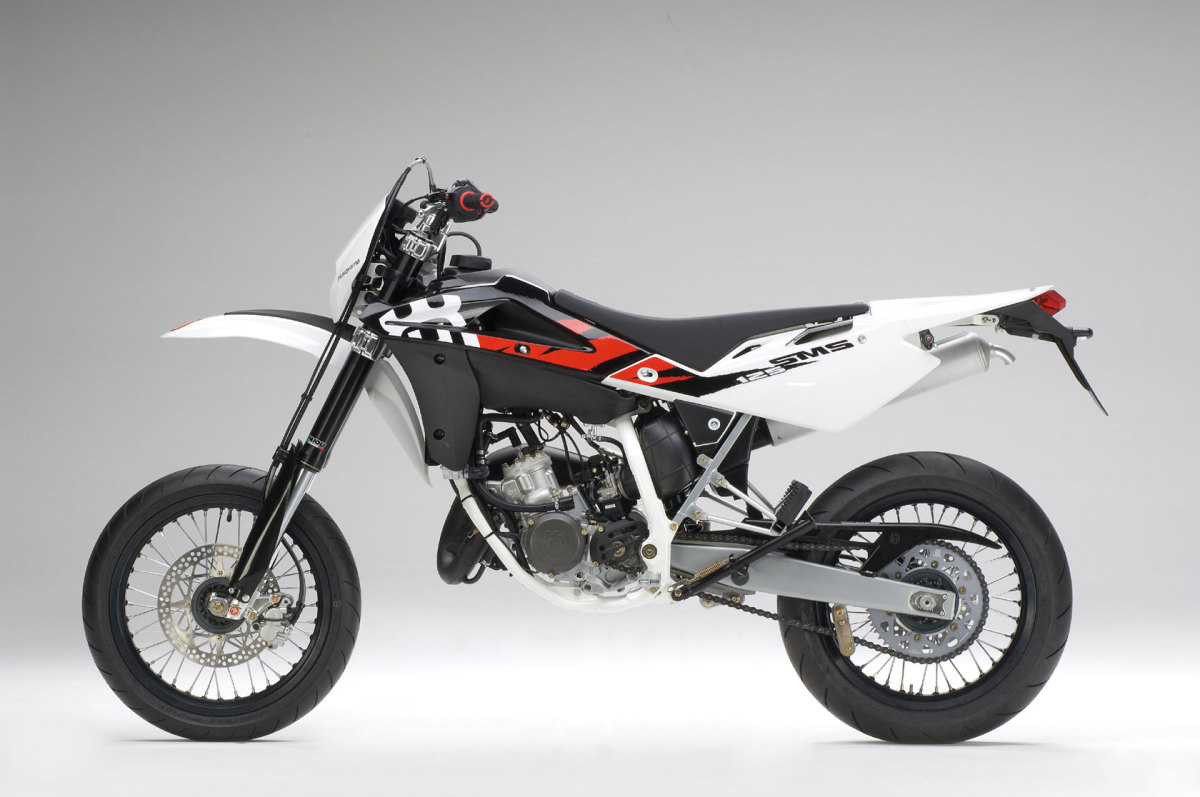 The outrageous 2009 Husqvarna SM125: Add about a thousand dollars, shop around, and you can drive home on a 2009 Harley Davidson Sportster. Is anyone crazy enough to actually buy this thing at this price?