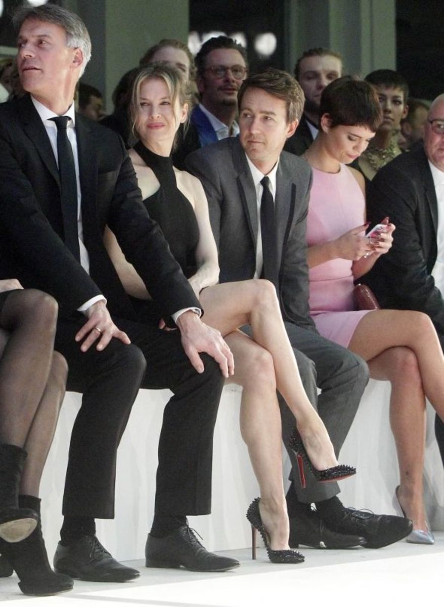 Renee Zellweger crossed legs at a fashion event