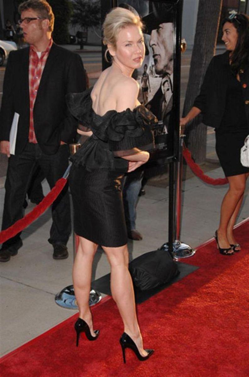 Renee Zellweger at the premiere of Appaloosa wearing towering high heel stilettos.