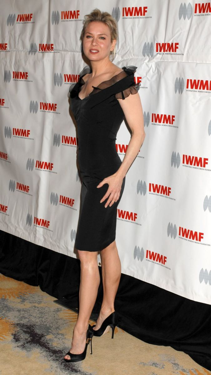 Renee Zellweger has sexy legs as she visits a Foundation wearing a black dress and high heels.