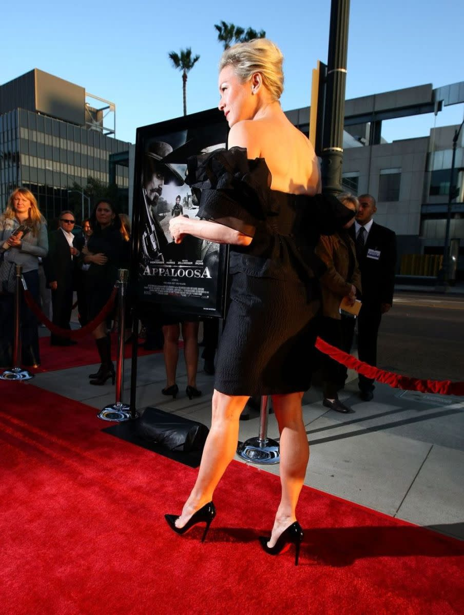 Renee Zellweger at the premiere of Appaloosa wearing towering high heel stilettos which accentuate her gorgeous legs.