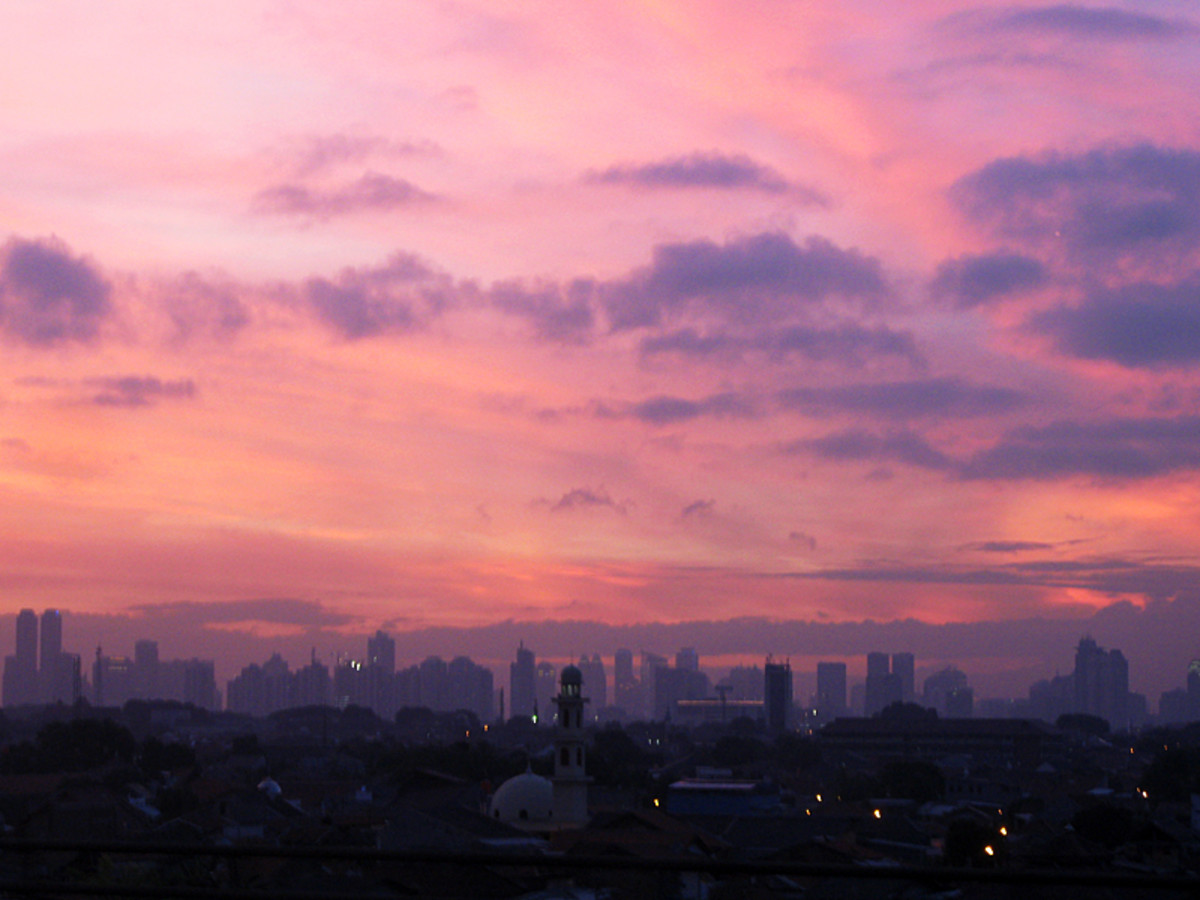 Photo of sunset over the Indonesian capital of Jakarta.  Photo by flydime and distributed under Creative Commons Attribution 2.0 license.
