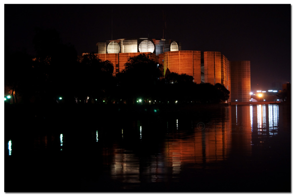 The parliament building of Bangladesh in Dhaka at night.  Photo by Silver Surfer -{ Ariful H Bhuiyan }- and distributed under Creative Commons Attribution 2.0 license.