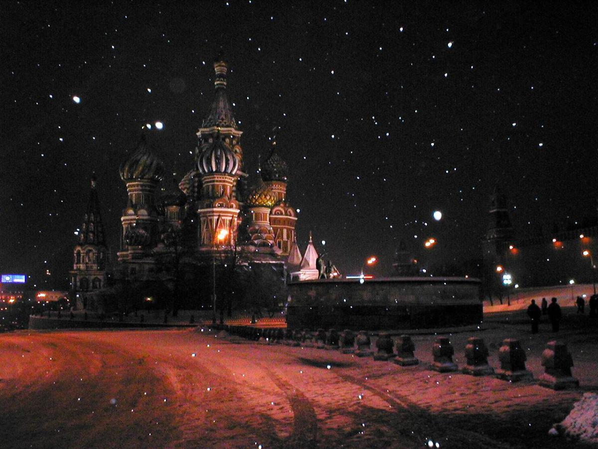 Photo of the snow falling on St. Basil's Cathedral and Red Square in Moscow.  Photo by lonesome:cycler and distributed under Creative Commons Attribution Sharealike 2.0 License.