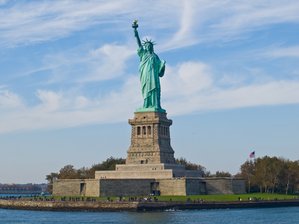 The Statue of Liberty is located on Liberty Island in New York.  Given to America as a gift by France, it was one of the first parts of America to be seen by many immigrants from Europe.  Photo by wwarby and distributed under Attribution 2.0 license.