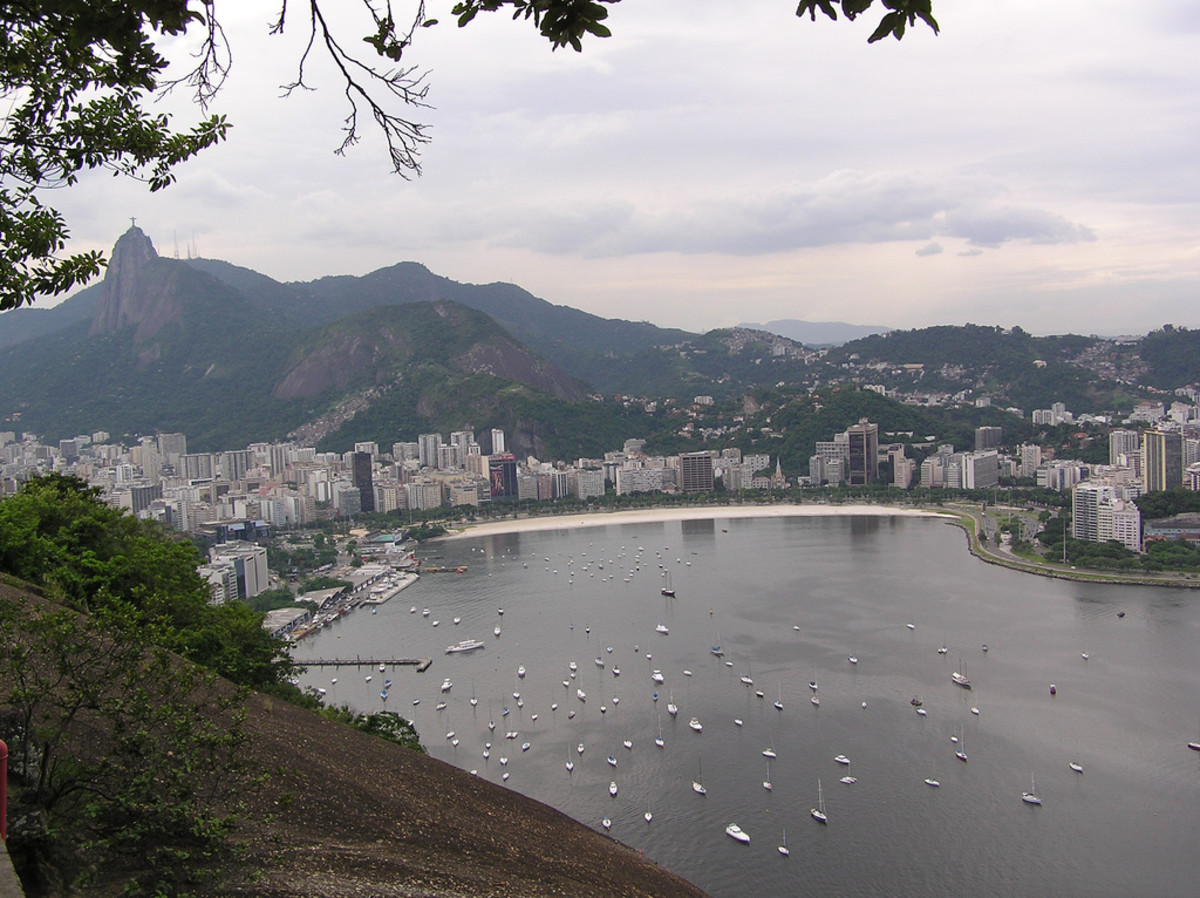 View of Rio de Janeiro in Brazil.  The statue Christ the Redeemr can just be seen in the top left of this picture on top of the hill.  Distributed under Creative Commons Attricution-No Derivative works license, the photo is by Chang'r.