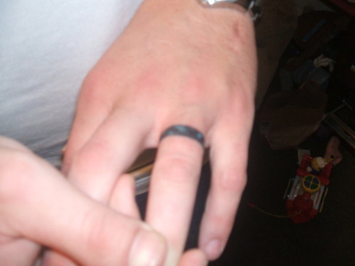 Blue and Black Men's Modern Wedding Ring Tattoo [http://www.checkoutmyink.com/tattoos/jlord/wedding-ring-1]
