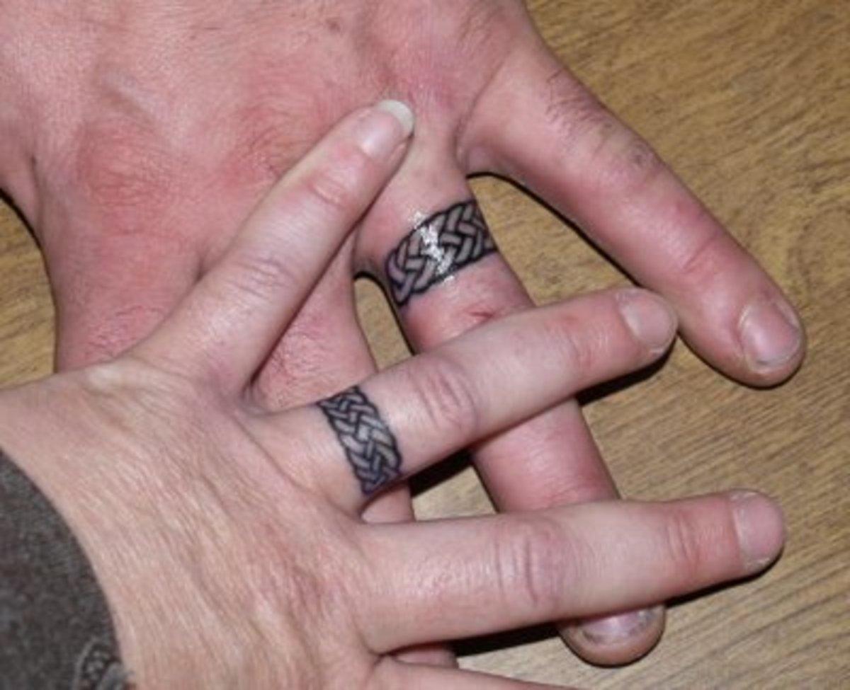 Celtic Wedding Ring Tattoo [http://www.tattoopicturesndesigns.com/2008/06/wedding-rings.html]